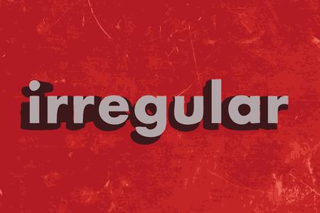 irregular: irregular word on red concrete wall