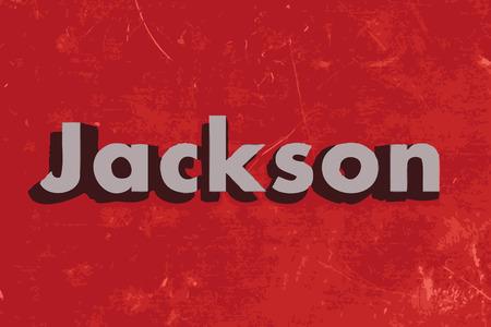 jackson: Jackson word on red concrete wall
