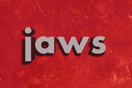 jaws: jaws word on red concrete wall