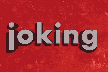 joking: joking word on red concrete wall