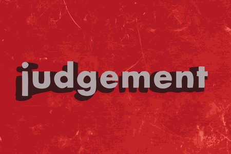 judgements: judgement word on red concrete wall