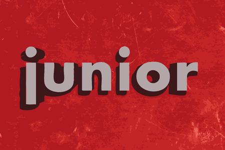 junior: junior word on red concrete wall Illustration