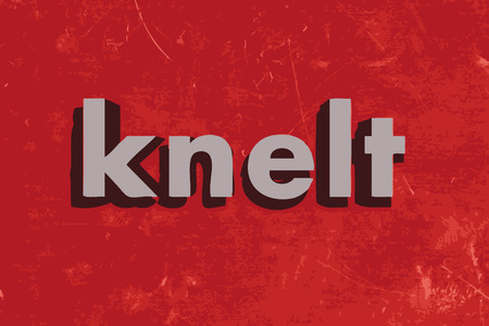 knelt: knelt word on red concrete wall