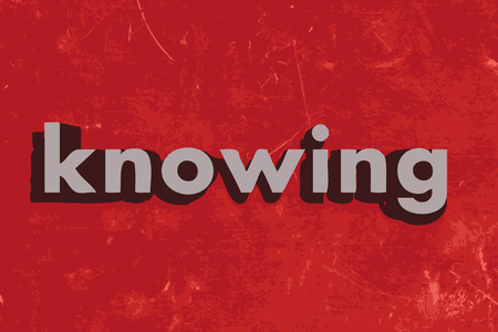 knowing: knowing word on red concrete wall
