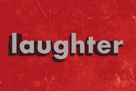 risas: palabra risa en rojo muro de hormig�n
