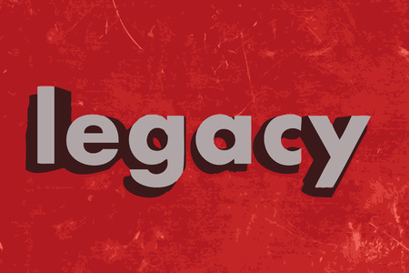 legacy: legacy word on red concrete wall