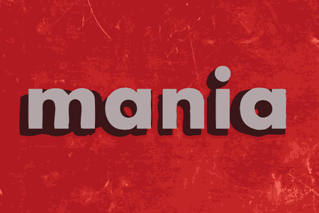 mania: mania vector word on red concrete wall