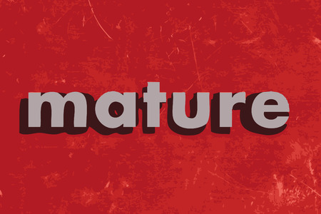 mature: mature vector word on red concrete wall