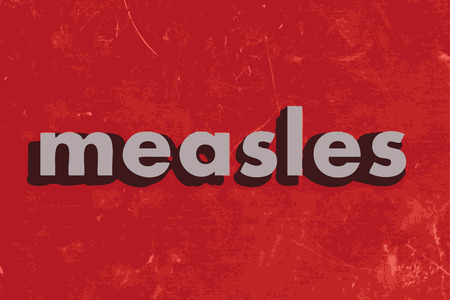 measles: measles vector word on red concrete wall