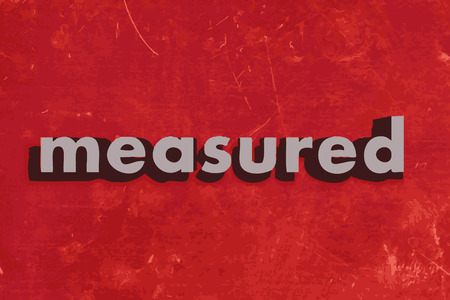 measured: measured vector word on red concrete wall
