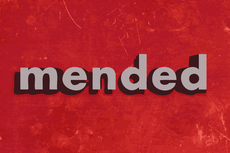 mended: mended vector word on red concrete wall