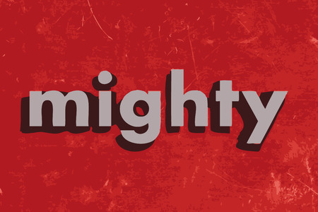 mighty: mighty vector word on red concrete wall