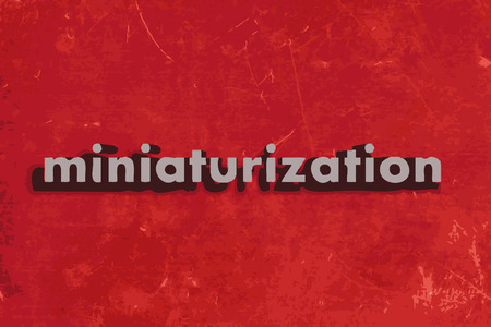 miniaturization: miniaturization vector word on red concrete wall