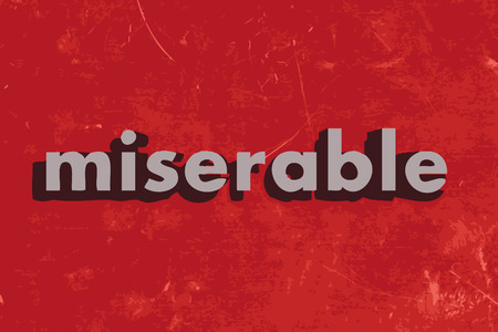 miserable: miserable vector word on red concrete wall