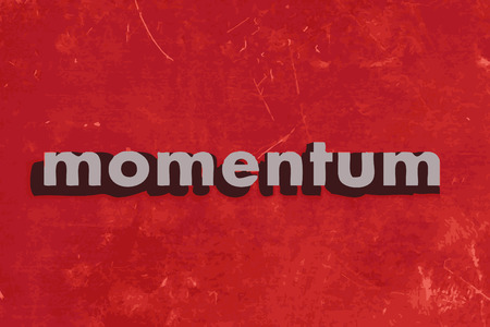 momentum: momentum vector word on red concrete wall
