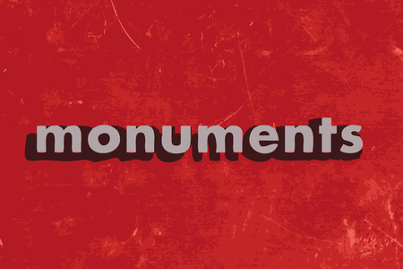 monuments: monuments vector word on red concrete wall