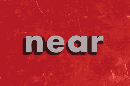 near: near vector word on red concrete wall