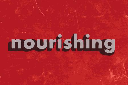 nourishing: nourishing vector word on red concrete wall