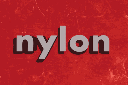nylon: nylon vector word on red concrete wall