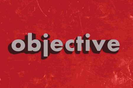 objective: objective vector word on red concrete wall