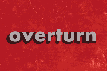 overturn: overturn vector word on red concrete wall
