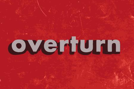overturn: ribaltare parola vettoriale su muro di cemento rosso