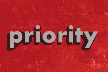 priority: priority vector word on red concrete wall