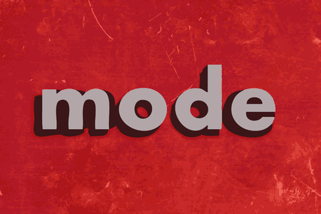 mode vector word on red concrete wall