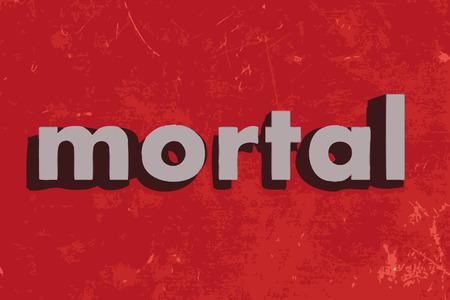 mortal: mortal vector word on red concrete wall