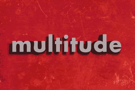 moltitudine: moltitudine parola vettore sul muro di cemento rosso