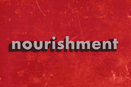 nourishment: nourishment vector word on red concrete wall