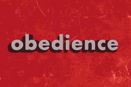 obediencia: palabra obediencia vector en rojo muro de hormig�n