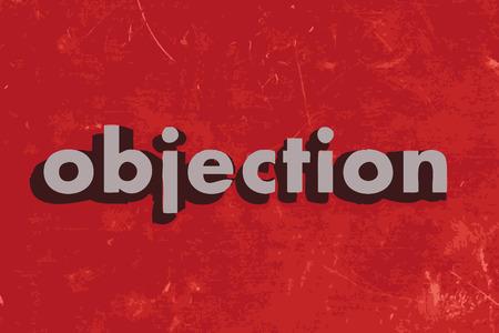 objecion: palabra objeci�n vector en rojo muro de hormig�n