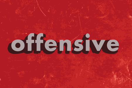 offensive: offensive vector word on red concrete wall