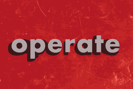 operate: operate vector word on red concrete wall