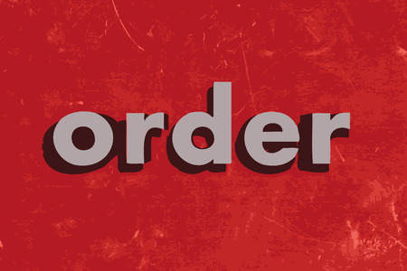 in order: order vector word on red concrete wall