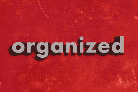 organized: organized vector word on red concrete wall Illustration