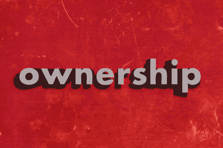 ownership: ownership vector word on red concrete wall