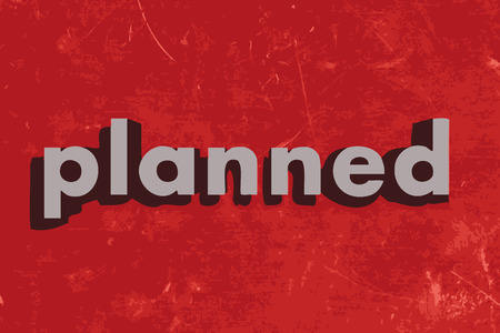 planned: planned vector word on red concrete wall