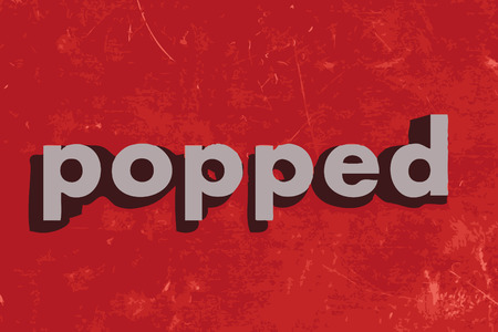 popped: popped vector word on red concrete wall