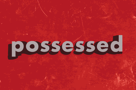 possessed: possessed vector word on red concrete wall