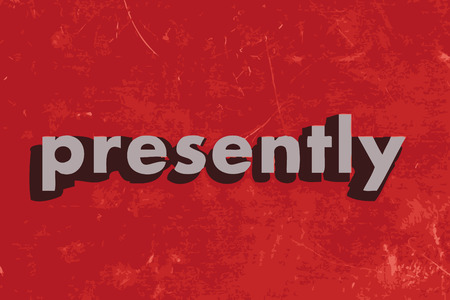 presently: presently vector word on red concrete wall