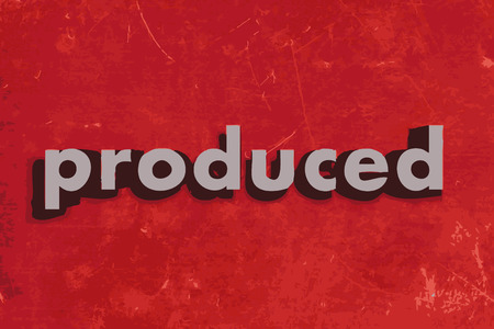 produced: produced vector word on red concrete wall