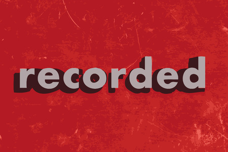 recorded: recorded vector word on red concrete wall