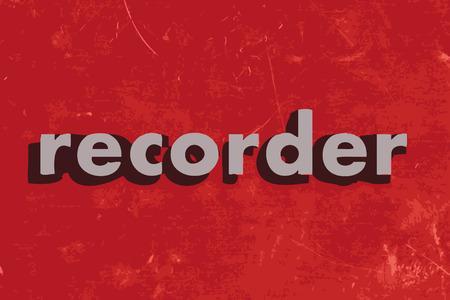 grabadora: palabra grabadora del vector en rojo muro de hormig�n