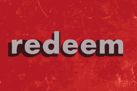 redeem: redeem vector word on red concrete wall