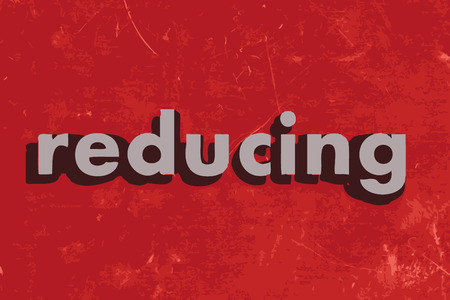 reducing: reducing vector word on red concrete wall