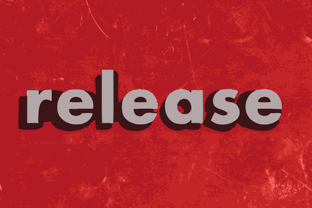 release: release vector word on red concrete wall