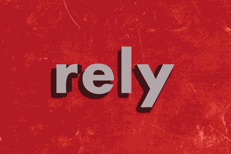 rely: rely vector word on red concrete wall