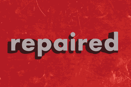 repaired: repaired vector word on red concrete wall